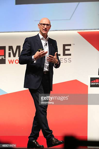 Tim Hoettges chief executive officer of Deutsche Telekom AG gestures whilst speaking during a keynote session at the Mobile World Congress in...