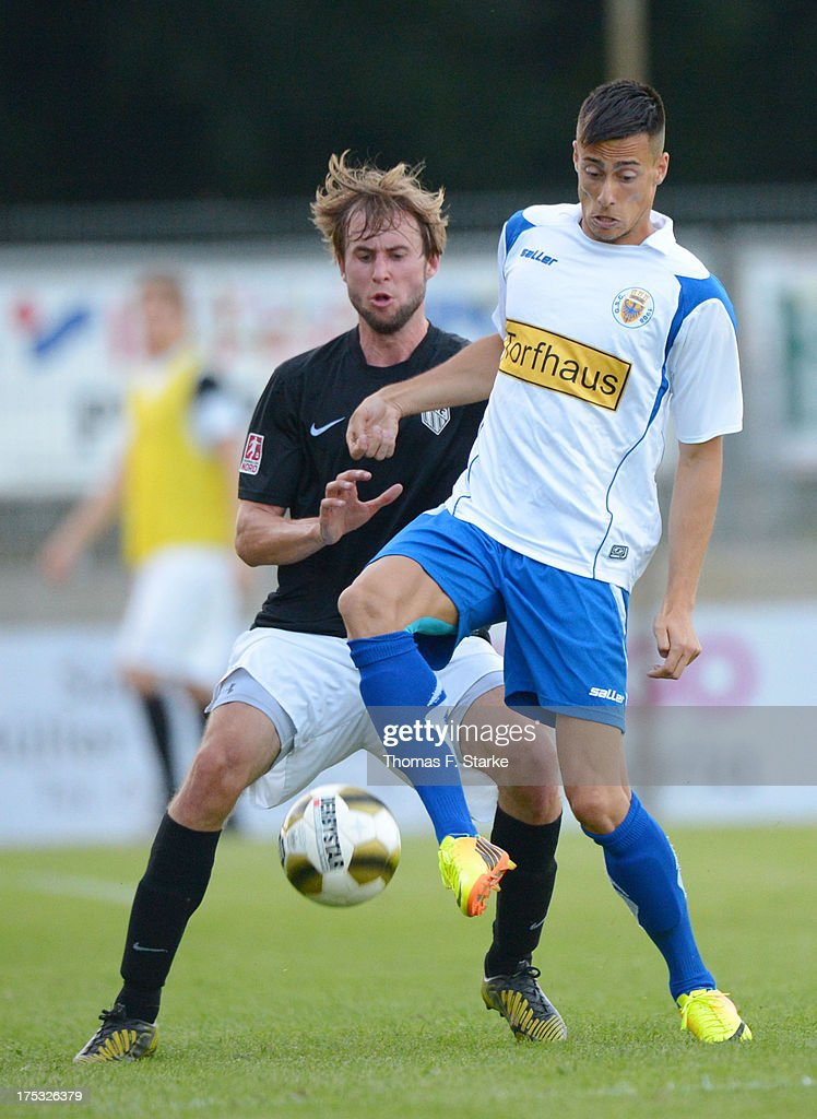 Tim Hofmann (L) of Cloppenburg and Darko Anic of Goslar fight for the ball during the Regionalliga North match between BV Cloppenburg and Goslarer SC at stadium Cloppenburg on August 2, 2013 in Cloppenburg, Germany.