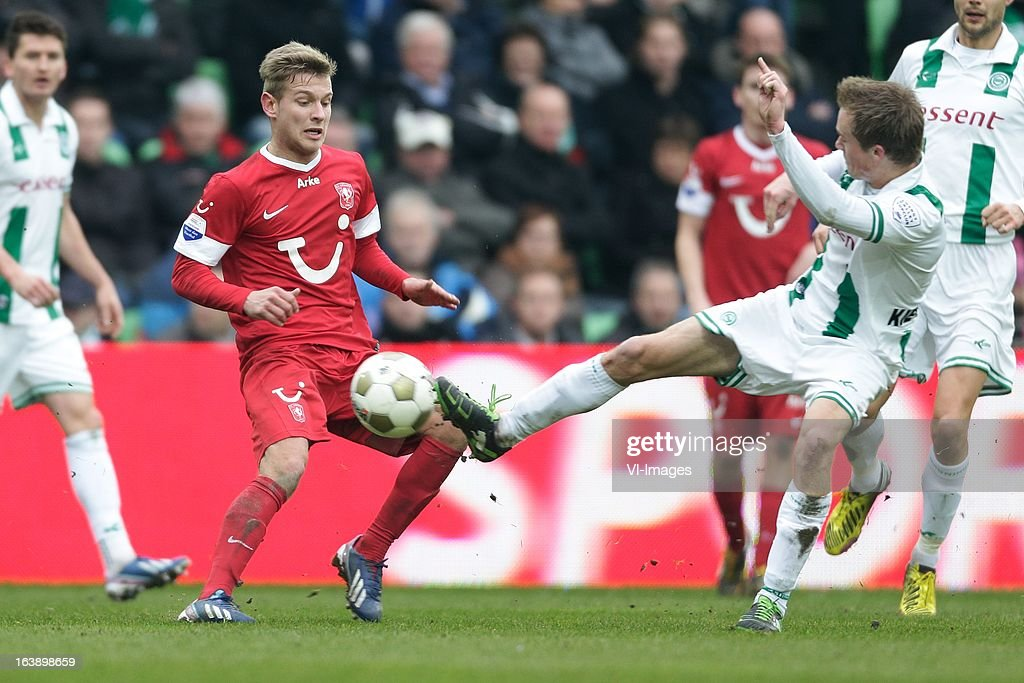 Tim Holscher of FC Twente (L) Maikel Kieftenbeld of FC Groningen (R) during the Dutch Eredivisie match between FC Groningen and FC Twente at the Euroborg Stadium on march 17, 2013 in Groningen, The Netherlands
