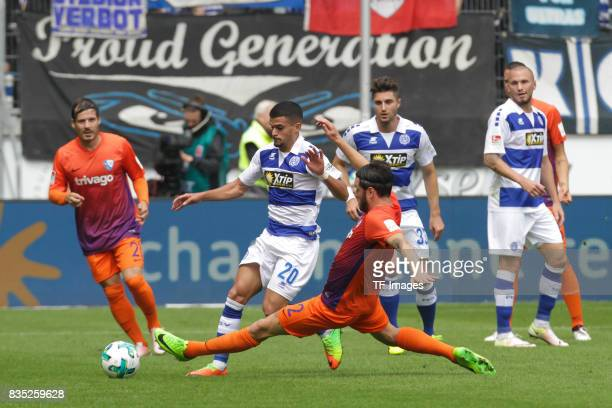 Tim Hoogland of Bochum graetscht and Cauly Oliveira Souza battle for the ball during the Second Bundesliga match between MSV Duisburg and VfL Bochum...