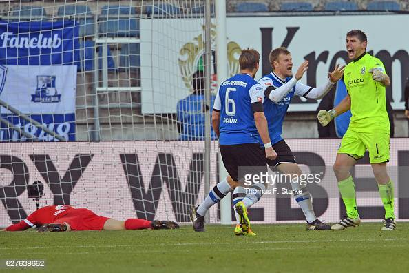 Tim Hoogland of Bochum looks dejected while Tom Schuetz Brian Behrendt and Wolfgang Hesl of Bielefeld celebrate during the Second Bundesliga match...
