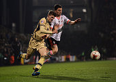 Tim Hoogland of Fulham battles with Sam Byram of Leeds United during the Sky Bet Championship match between Fulham and Leeds United at Craven Cottage...