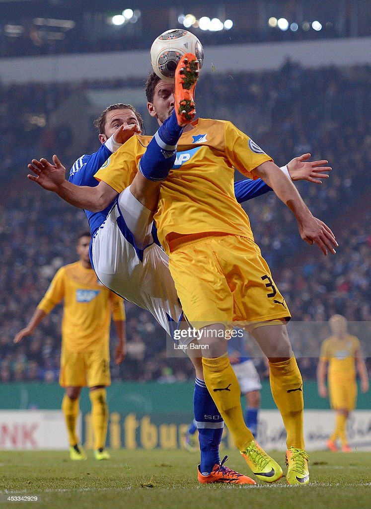 <a gi-track='captionPersonalityLinkClicked' href=/galleries/search?phrase=Tim+Hoogland&family=editorial&specificpeople=764216 ng-click='$event.stopPropagation()'>Tim Hoogland</a> of Schalke challenges Kai Herdling of Hoffenheim during the DFB Cup round of 16 match between FC Schalke 04 and 1899 Hoffenheim at Veltins-Arena on December 3, 2013 in Gelsenkirchen, Germany.