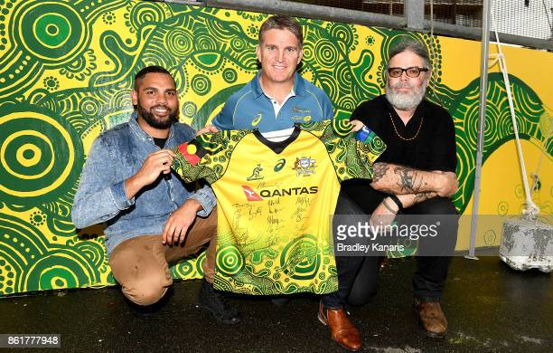 Tim Horan CR Krista Adams and Wallabies Indigenous jersey artist Denis Goulding pose for a photo during an ARU media opportunity on October 16 2017...