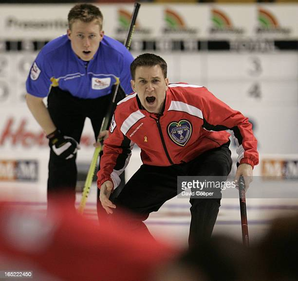 NL skip Brad Gushue calls the sweeping watched by Alberta second Marc Kennedy in the 11th end against Aberta NL won 86 in 11 ends