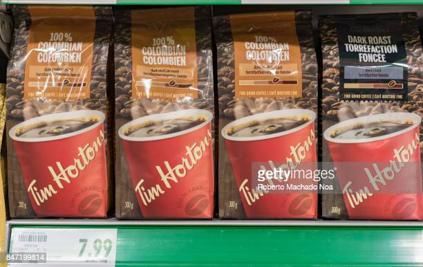 Tim Horton's coffee packs on display on a grocery store shelf Price tag below Both the Colombian and dry roast packs feature an image of a red glass...