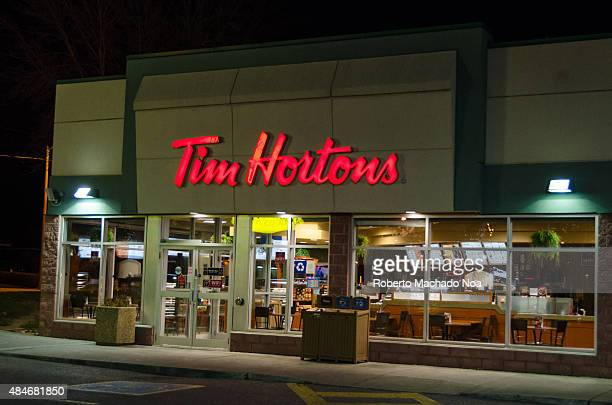 Tim Horton's restaurant during a Winter night with snow Tim Hortons Inc is a Canadian multinational fast casual restaurant known for its coffee and...