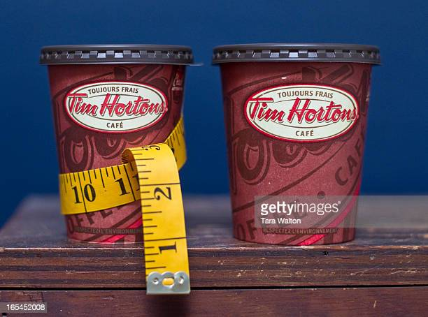 Tim Hortons small and medium coffee cups are photographed side by side Monday August 29 2011 Photos to illustrate an article on a new pilot project...