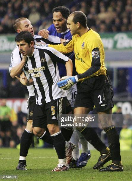 Tim Howard and Joleon Lescott of Everton argue with Emre Belozoglu of Newcastle after Newcastle were awarded a penalty during the Barclays...