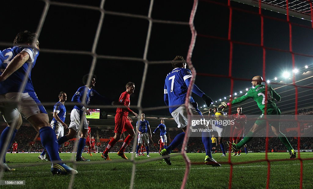 Tim Howard (24) and Nikica Jelavic of Everton (7) attempt to clear the ball away from their goal during the Barclays Premier League match between Southampton and Everton at St Mary's Stadium on January 21, 2013 in Southampton, England.