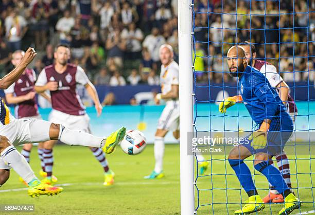 Tim Howard of Colorado Rapids watches a header from Daniel Steres of Los Angeles Galaxy go into the goal during Los Angeles Galaxy's MLS match...