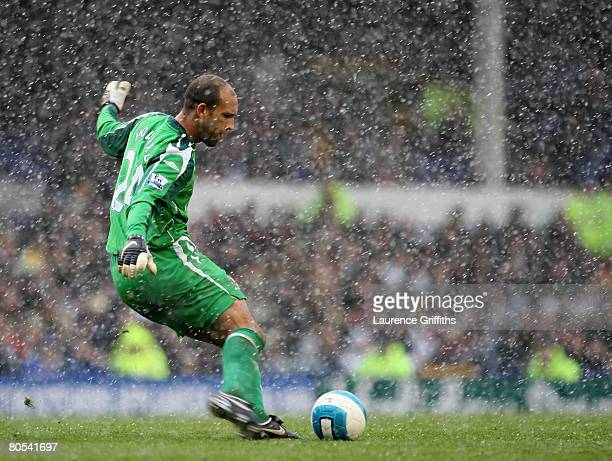 Tim Howard of Everton clears the ball during a snow shower during the Barclays Premier League match between Everton and Derby County at Goodison Park...