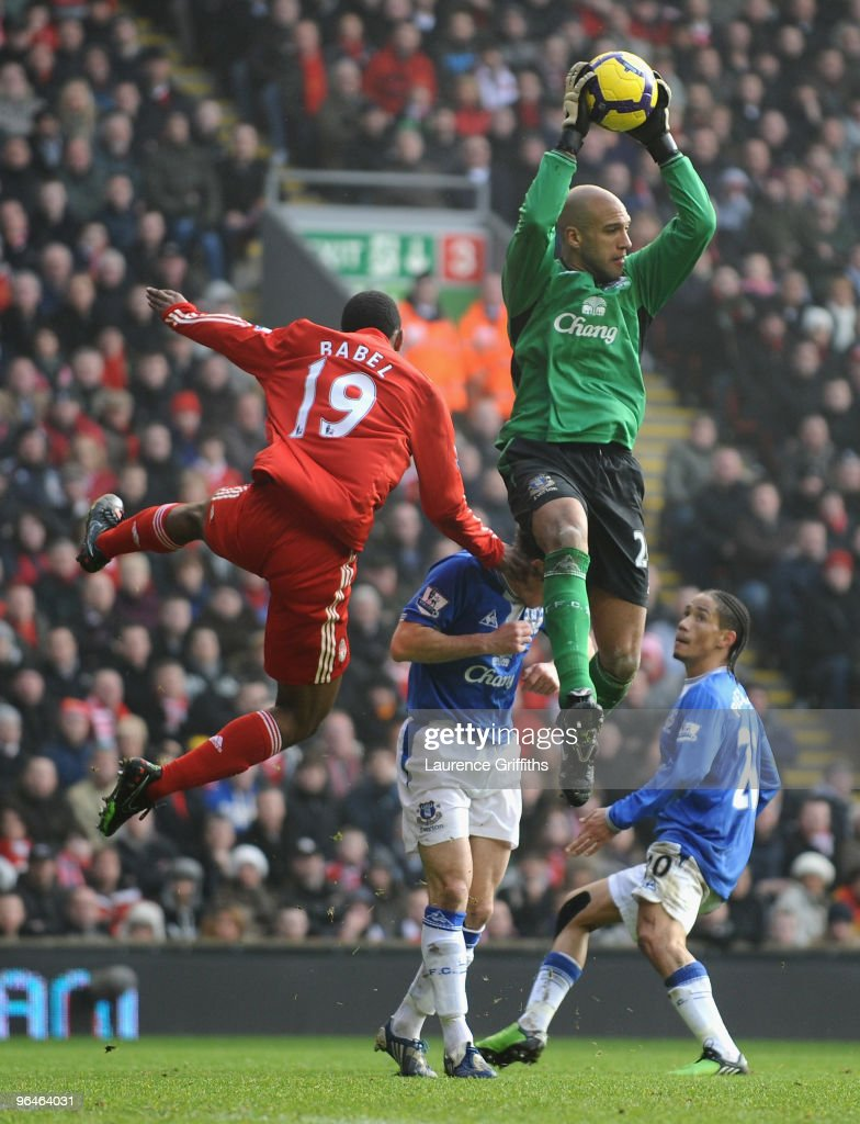 Tim Howard of Everton leaps to claim the ball under pressure from Ryan Babel of Liverpool during the Barclays Premier League match between Liverpool...