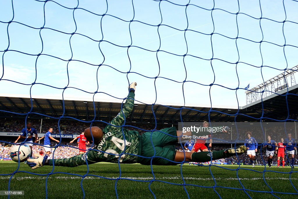 Tim Howard of Everton saves the penalty kick of Dirk Kuyt of Liverpool during the Barclays Premier League match between Everton and Liverpool at...