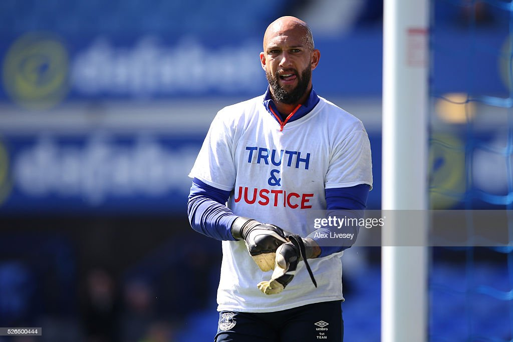 Tim Howard of Everton wearing shirts to commemorate the Hillsborough disaster victims warms up prior to the Barclays Premier League match between Everton and A.F.C. Bournemouth at Goodison Park on April 30, 2016 in Liverpool, England.