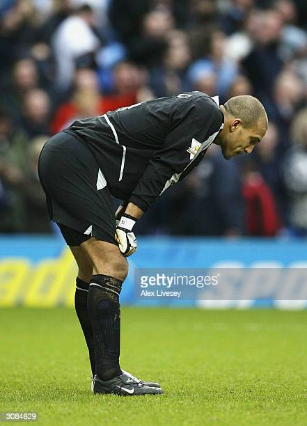 Tim Howard of Manchester United looks dejected after Manchester City's fourth goal during the FA Barclaycard Premiership match between Manchester...