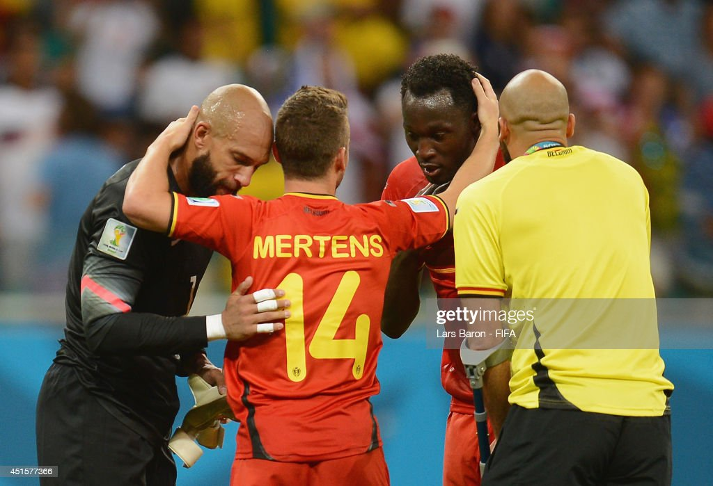 Tim Howard (1st L) of the United States and Romelu Lukaku (2nd R), Anthony Vanden Borre (1st R) and Dries Mertens (2nd L) of Belgium applaud after the 2014 FIFA World Cup Brazil Round of 16 match between Belgium and USA at Arena Fonte Nova on July 1, 2014 in Salvador, Brazil.