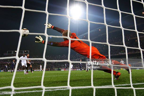 Tim Howard of the United States dives to make a save from Emile Heskey of England during the 2010 FIFA World Cup South Africa Group C match between...