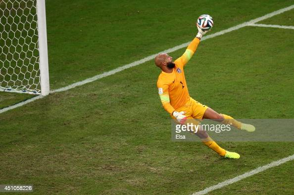 Tim Howard of the United States makes a save during the 2014 FIFA World Cup Brazil Group G match between the United States and Portugal at Arena...