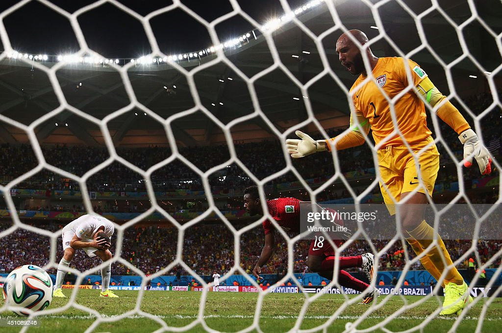 <a gi-track='captionPersonalityLinkClicked' href=/galleries/search?phrase=Tim+Howard+-+Soccer+Player&family=editorial&specificpeople=11515558 ng-click='$event.stopPropagation()'>Tim Howard</a> of the United States reacts as <a gi-track='captionPersonalityLinkClicked' href=/galleries/search?phrase=Silvestre+Varela&family=editorial&specificpeople=607288 ng-click='$event.stopPropagation()'>Silvestre Varela</a> of Portugal scores his team's second goal during the 2014 FIFA World Cup Brazil Group G match between the United States and Portugal at Arena Amazonia on June 22, 2014 in Manaus, Brazil.