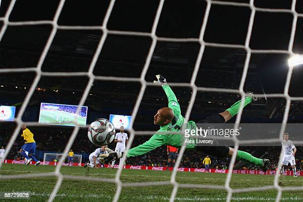 Tim Howard of USA is unable to stop Luis Fabiano of Brazil scoring his team's first goal during the FIFA Confederations Cup Final between USA and...