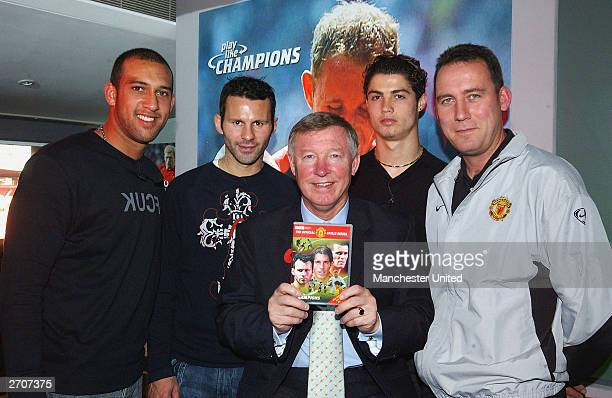 Tim Howard Ryan Giggs Sir Alex Ferguson Cristiano Ronaldo and coach Rene Meulensteen pose with the newly released skills DVD at the Play Like...