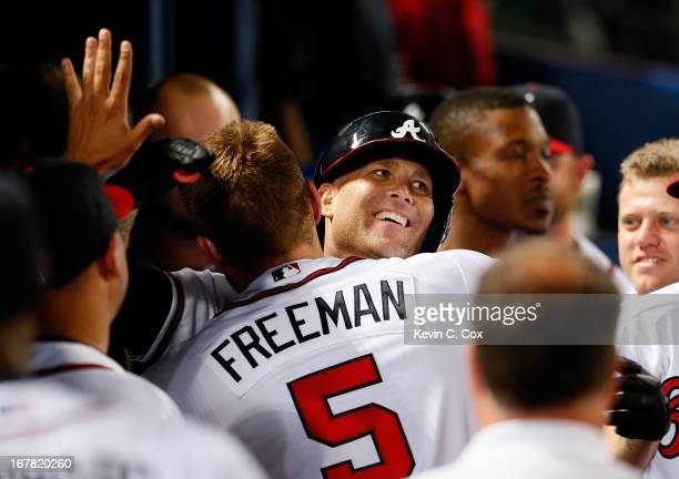 Tim Hudson of the Atlanta Braves celebrates his solo homer in the fifth inning against the Washington Nationals with Freddie Freeman at Turner Field...