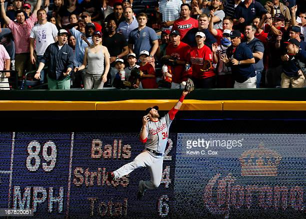 Tim Hudson of the Atlanta Braves hits a solo homer off Bryce Harper of the Washington Nationals in the fifth inning at Turner Field on April 30 2013...