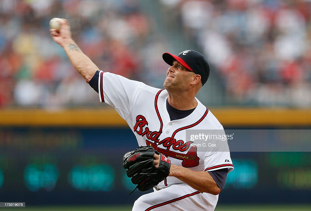 <a gi-track='captionPersonalityLinkClicked' href=/galleries/search?phrase=Tim+Hudson&family=editorial&specificpeople=203108 ng-click='$event.stopPropagation()'>Tim Hudson</a> #15 of the Atlanta Braves pitches in the first inning to the Cincinnati Reds at Turner Field on July 11, 2013 in Atlanta, Georgia.
