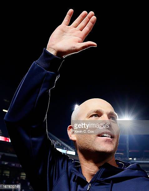 Tim Hudson of the Atlanta Braves waves to the fans after his 200th career win in a 81 victory over the Washington Nationals at Turner Field on April...