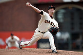 Tim Hudson of the San Francisco Giants pitches in the first inning against the St Louis Cardinals during Game Three of the National League...
