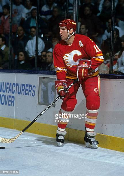 Tim Hunter of the Calgary Flames controls the puck behind the net during an NHL game circa 1989