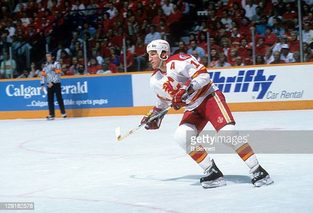 Tim Hunter of the Calgary Flames skates on the ice during the 1989 Stanley Cup Finals against the Montreal Canadiens in May 1989 at the Olympic...