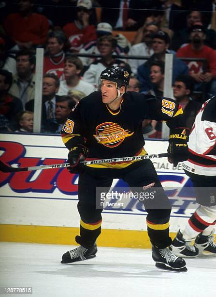 Tim Hunter of the Vancouver Canucks skates on the ice during an NHL game against the New Jersey Devils on October 25 1995 at the Continental Airlines...