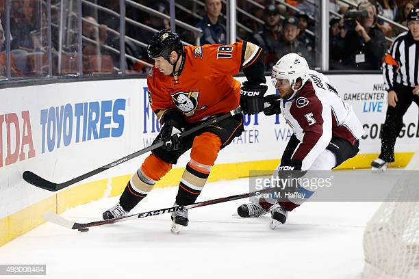 Tim Jackman of the Anaheim Ducks and Nate Guenin of the Colorado Avalanche skate to the puck during the first period of a game at Honda Center on...