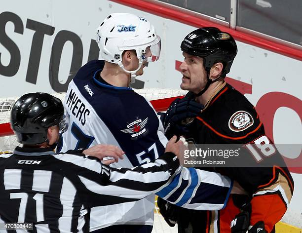 Tim Jackman of the Anaheim Ducks exchanges words with Tyler Myers of the Winnipeg Jets in Game Two of the Western Conference Quarterfinals between...