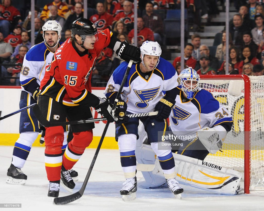 Tim Jackman of the Calgary Flames battles for position in front of the net with Scott Nichol of the St Louis Blues during an NHL game at Scotiabank...