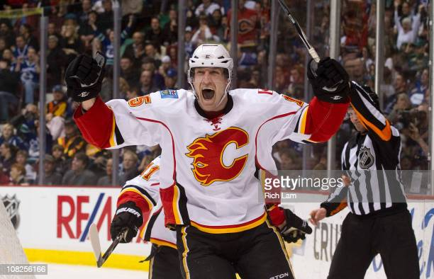 Tim Jackman of the Calgary Flames celebrates after scoring against the Vancouver Canucks during the third period in NHL action on January 22 2011 at...