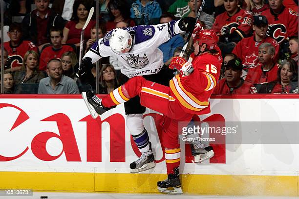 Tim Jackman of the Calgary Flames collides along the boards against Peter Harrold of the Los Angeles Kings on October 10 2010 at the Scotiabank...