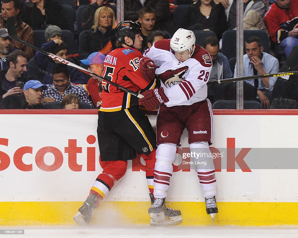 <a gi-track='captionPersonalityLinkClicked' href=/galleries/search?phrase=Tim+Jackman&family=editorial&specificpeople=2077074 ng-click='$event.stopPropagation()'>Tim Jackman</a> #15 of the Calgary Flames collides with Michael Stone #29 of the Phoenix Coyotes during an NHL game at Scotiabank Saddledome on April 12, 2013 in Calgary, Alberta, Canada.