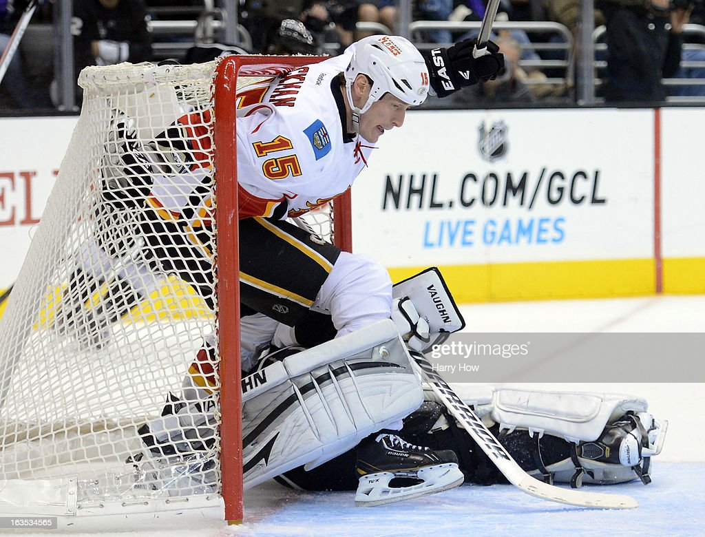 Tim Jackman #15 of the Calgary Flames crashes the net through Jonathan Quick #32 of the Los Angeles Kings during the third period at Staples Center on March 11, 2013 in Los Angeles, California. The Kings won 3-1.