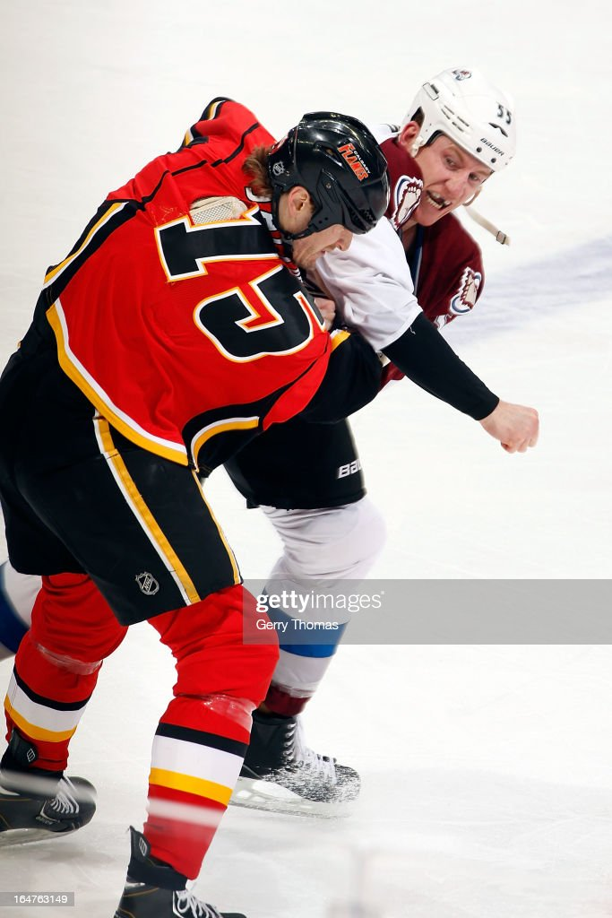 <a gi-track='captionPersonalityLinkClicked' href=/galleries/search?phrase=Tim+Jackman&family=editorial&specificpeople=2077074 ng-click='$event.stopPropagation()'>Tim Jackman</a> #15 of the Calgary Flames fights <a gi-track='captionPersonalityLinkClicked' href=/galleries/search?phrase=Cody+McLeod&family=editorial&specificpeople=2242985 ng-click='$event.stopPropagation()'>Cody McLeod</a> #55 of the Colorado Avalanche on March 27, 2013 at the Scotiabank Saddledome in Calgary, Alberta, Canada.