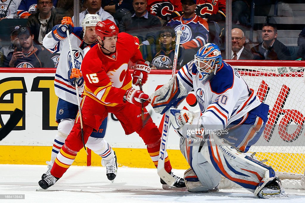 Tim Jackman #15 of the Calgary Flames looks for a rebound against Devan Dubnyk #40 of the Edmonton Oilers on April 3, 2013 at the Scotiabank Saddledome in Calgary, Alberta, Canada.