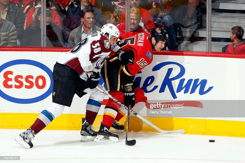 Tim Jackman #15 of the Calgary Flames skates against Patrick Bordeleau #58 of the Colorado Avalanche on March 27, 2013 at the Scotiabank Saddledome in Calgary, Alberta, Canada.
