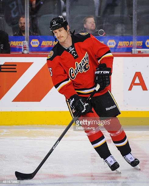 Tim Jackman of the Calgary Flames skates against the Edmonton Oilers during an NHL game at Scotiabank Saddledome on November 16 2013 in Calgary...