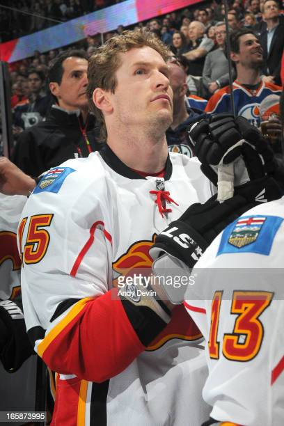 Tim Jackman of the Calgary Flames stands for the singing of the national anthem prior to a game against the Edmonton Oilers on April 1 2013 at Rexall...