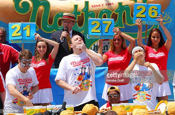 Tim Janus Joey Chestnut and Matt Stonie compete in the Nathan's Famous Fourth of July Hot Dog Eating Contest at Nathan's Famous in Coney Island on...