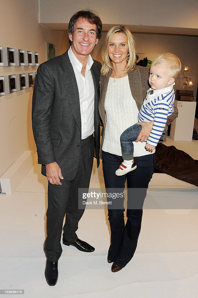 <a gi-track='captionPersonalityLinkClicked' href=/galleries/search?phrase=Tim+Jefferies&family=editorial&specificpeople=212724 ng-click='$event.stopPropagation()'>Tim Jefferies</a> (L) and wife Malin Jefferies with son Rex attend a private preview of the PAD London 2012 Pavilion of Design in Berkeley Square Gardens on October 9, 2012 in London, England.
