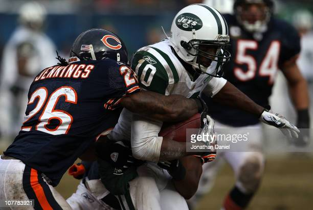Tim Jennings and Nick Roach of the Chicago Bears bring down Santonio Holmes of the New York Jets at Soldier Field on December 26 2010 in Chicago...
