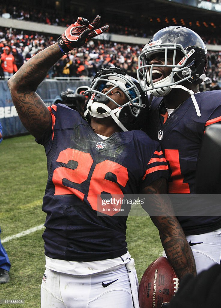 Tim Jennings #26 of the Chicago Bears celebrates with a teammate after scoring a touchdown on an interception against the Carolina Panthers on October 28, 2012 at Soldier Field in Chicago, Illinois. The Bears defeated the Panther 23-22.